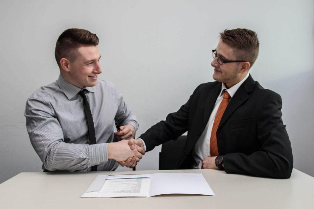 Happy businessman Shaking hands